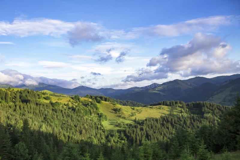 Scenic summer mountains view with cloudy sky. Carpathians stock photography