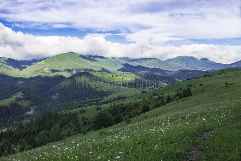 Scenic summer mountains view with cloudy sky. Carpathians royalty free stock images