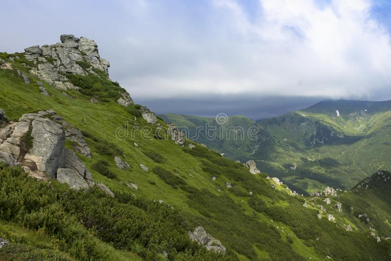 Scenic summer mountains view with cloudy sky. Carpathians royalty free stock image