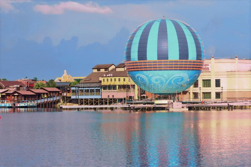 Scenic summer sunset view of Lake Buena Vista pier with color buildings, air balloon and boats stock image