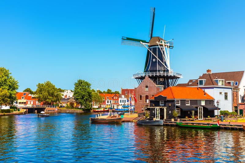 Old Town of Haarlem, Netherlands. Scenic summer view of the Old Town architecture, mill and canal embankment in Haarlem, Netherlands royalty free stock photos