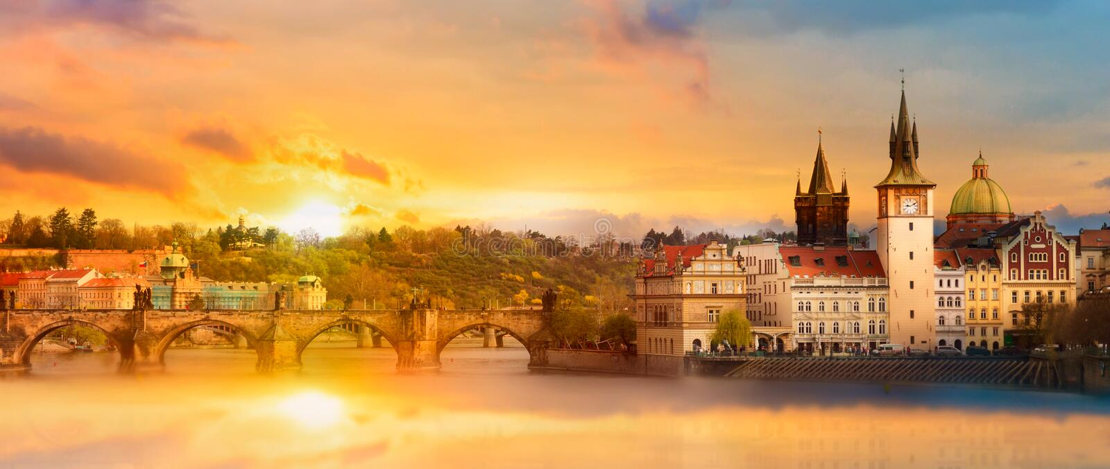 Scenic summer view of the Old Town buildings, Charles bridge and Vltava river in Prague during amazing sunset, Czech Republic.  stock images