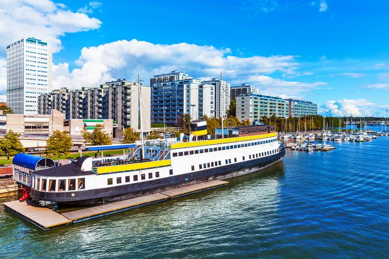 Scenic summer view of the Hakaniemi District in Helsinki, Finland. Scenic summer view of pier architecture and docked motor boats and yachts in Hakaniemi stock photo
