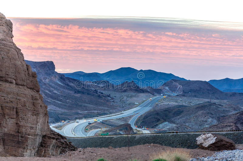 Scenic sunrise on a mountain road stock photography