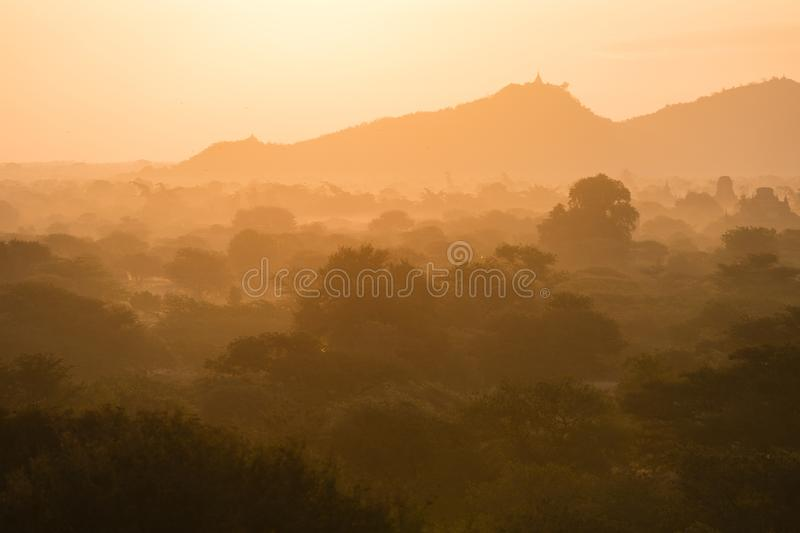 Scenic Sunrise over plain of Bagan on a misty morning stock photography