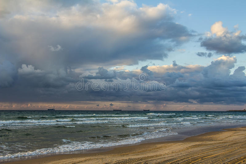 Scenic sunset and beach. With waves and clouds stock photo