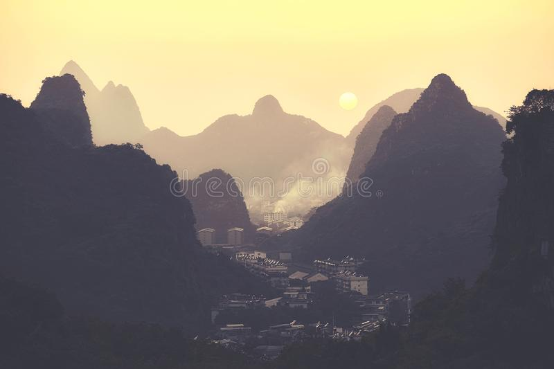 Scenic sunset over Karst mountains formations in Guilin, China. stock photo