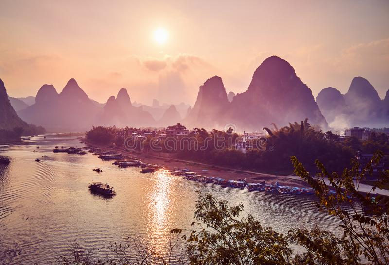 Scenic sunset over Li River in Xingping, China. Scenic sunset over Li River in Xingping, color toning applied, China stock photography