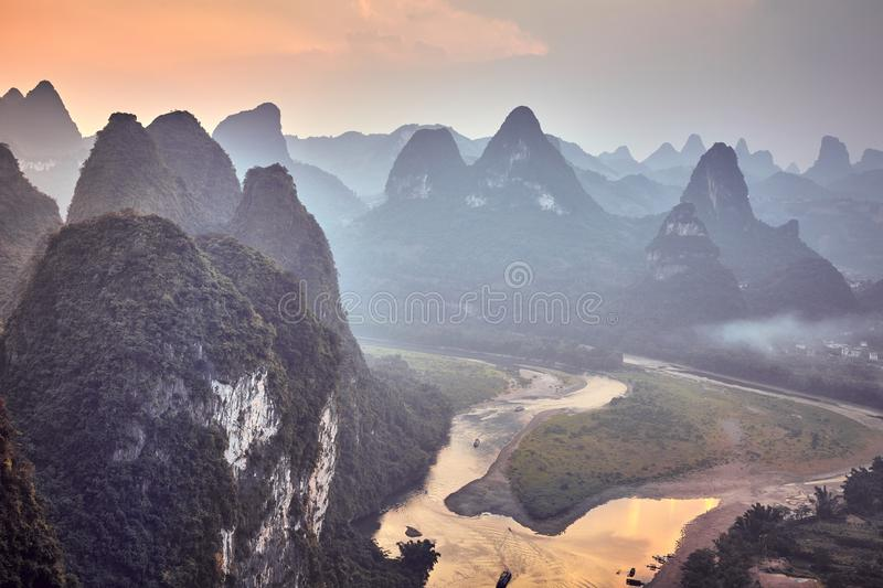 Scenic sunset over Li River, China. Scenic sunset over Lijiang River, color toning applied, Guangxi, China stock image