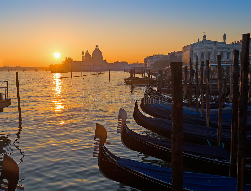 Scenic sunset in Venice. Scenic sunset with gondolas and church in Venice, Italy stock image