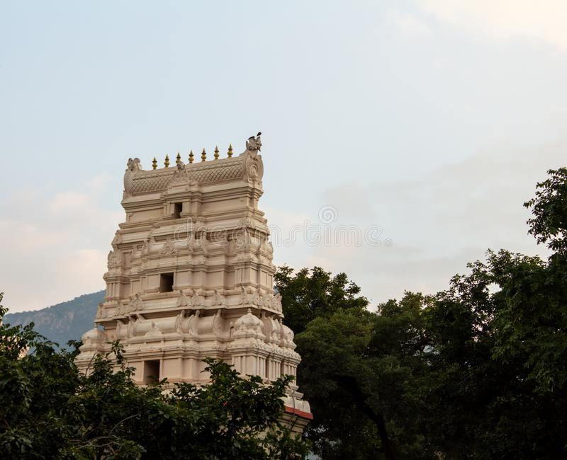 Beautiful temple tower along the mountain range of Salem, Tamil Nadu , India. Scenic temple tower in a hillock along the eastern ghats, Salem, Tamil Nadu , India stock photos