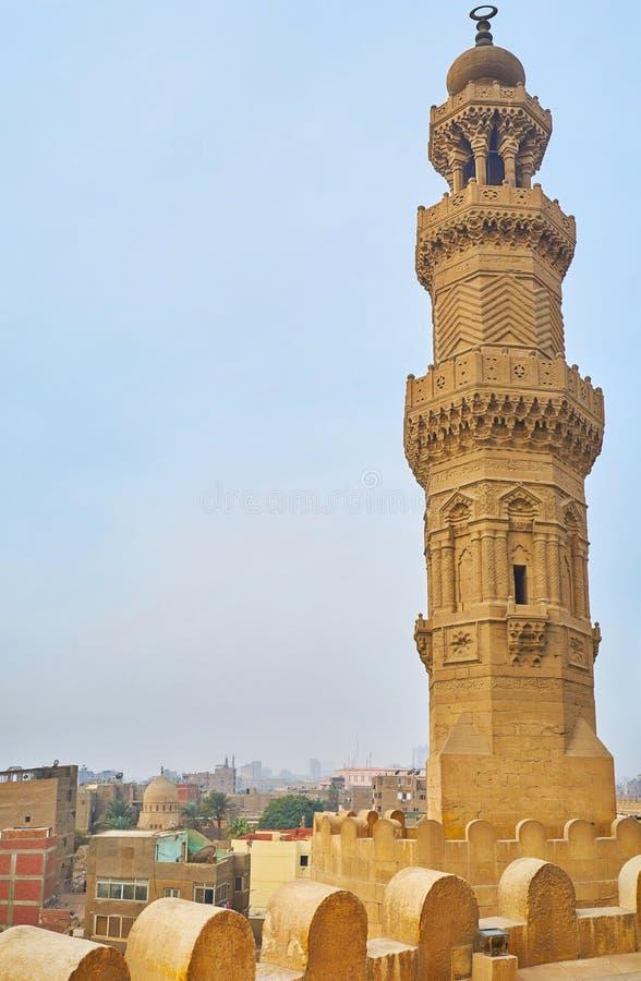 The scenic tower of Bab Zuwayla Gate, Cairo, Egypt. Bab Zuwayla gate boasts scenic towers with ornate carved decor, balconies, slender pillars and muqarnas stock image