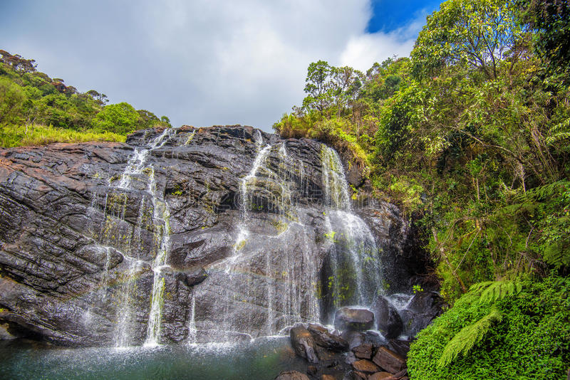 Scenic tropical waterfall. Bakers Falls In Horton Plains, Sri Lanka. The Height Of Bakers Waterfalls Is 20 Metres And The Falls Were Named After Sir Samuel Baker royalty free stock image