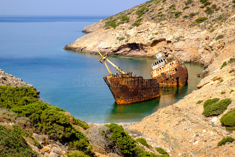 Scenic view of abandoned rusty shipwreck, Amorgos island. Cyclades, Greece stock photography