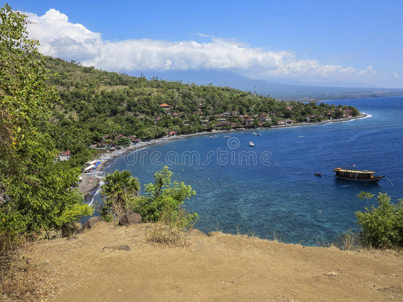 Scenic view of a Amed Bay in Bali with the volcano Mount Agung royalty free stock image