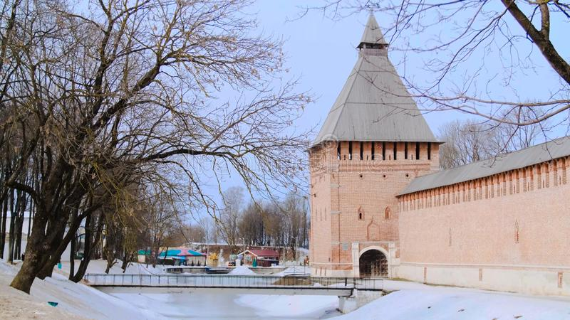 Scenic view of ancient brick wall with towers of old. Stock footage. Winter look of orthodox male monastery in Russian. Federation stock photography