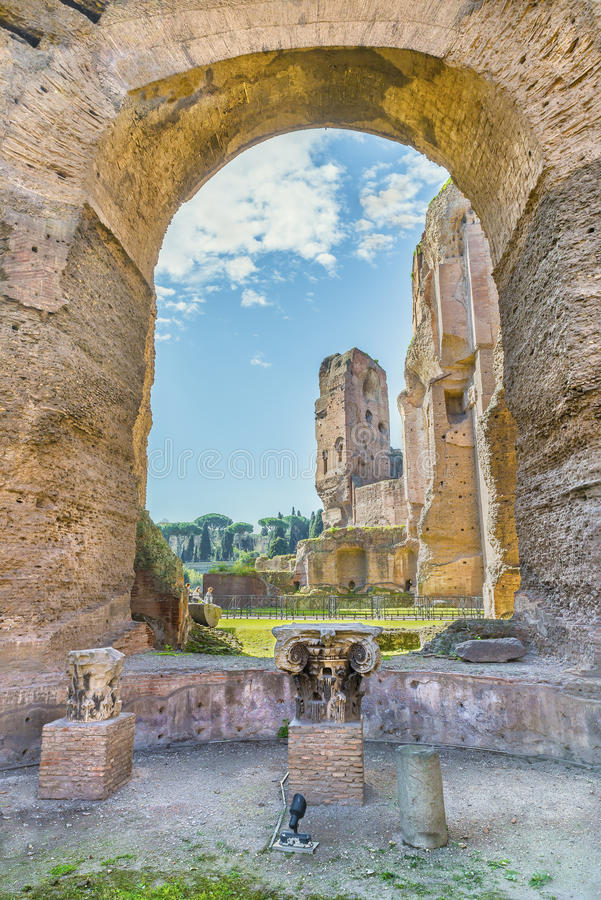 Scenic view through the arch and columns on the ruins of ancient Roman Baths of Caracalla. Scenic view through the arch and columns on the ruins of Frigidarium royalty free stock photography