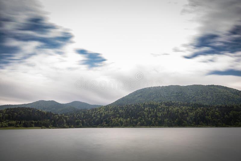 Scenic view on beautiful intermittent lake cerknica, with water in long exposure, spring season, slovenia. Scenic view on beautiful intermittent lake cerknica royalty free stock image