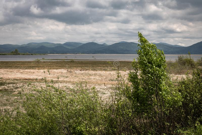 Scenic view on beautiful intermittent lake cerknica, with water, spring season, slovenia. Scenic view on beautiful intermittent lake cerknica, with water, spring royalty free stock image