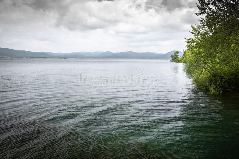 Scenic view on beautiful intermittent lake cerknica, with water, spring season, slovenia. Scenic view on beautiful intermittent lake cerknica, with water, spring stock photos