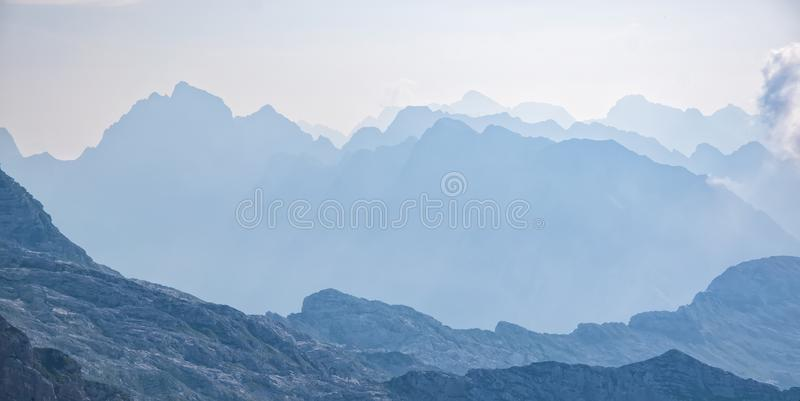 Scenic view of blue ridge in hazy mountains. Julian Alps stock photography