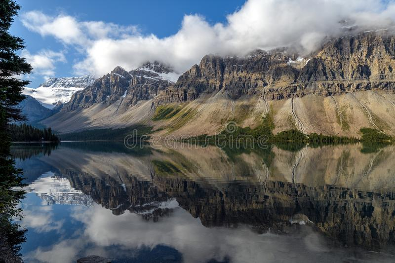 Scenic view of Bow Lake on the Icefields Parkway in Banff Nation. Scenic view of Bow Lake with a reflection of the mountains on the Icefields Parkway in Banff stock photo