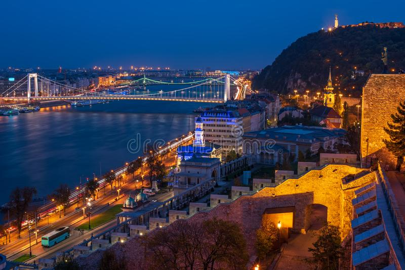 Scenic view of Budapest city at blue hour with illuminated Buda Castle, Citadella on Hellert Hill and Danube embankment royalty free stock photos