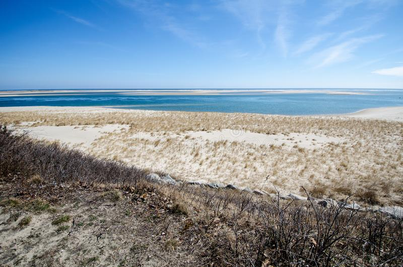 Scenic view of Cape Cod National Seashore on a sunny spring day. Seagrass and sand in the photo royalty free stock photos