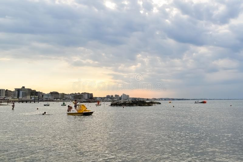 Scenic view of Cattolica seaside at sunset, Rimini, Italy. Scenic view of Cattolica seaside at sunset in a cloudy summer evening, Rimini, Italy stock photos