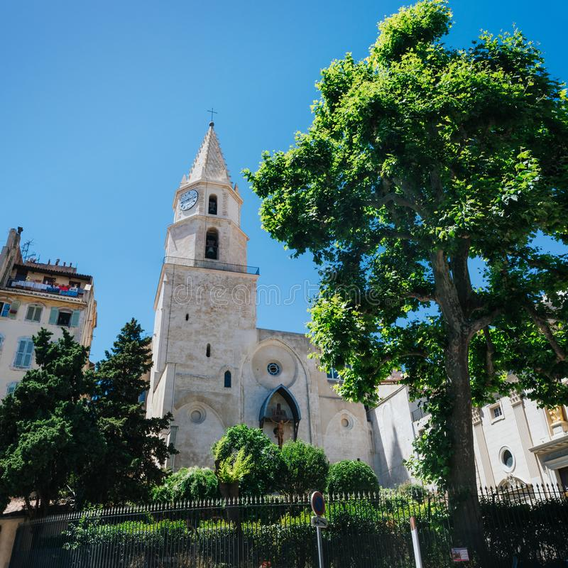 Scenic view of Church of Our Lady of Accoules (Notre Dame des Accoules) among fresh green trees, located in Daviel Square in. Panier neighborhood, Marseille royalty free stock image