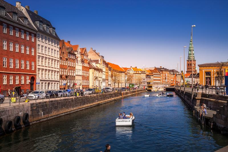 Scenic view of citysacpe with buildings and boats on Frederiksholm Canal. COPENHAGEN, DENMARK - MAY 6, 2018: scenic view of citysacpe with buildings and boats on stock image