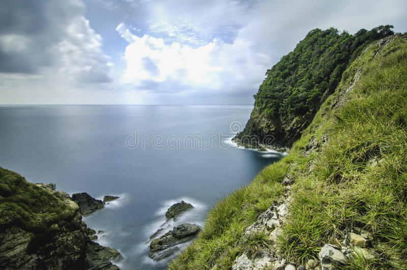 Scenic view from cliff top of Kapas Island, Terengganu, Malaysia. Cloudy and blue sky at sunny day royalty free stock photography