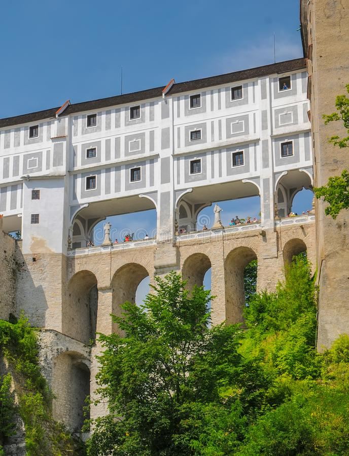 Scenic view of Cloak Bridge in castle in Cesky Krumlov, Czech Republic. UNESCO World Heritage Site royalty free stock image