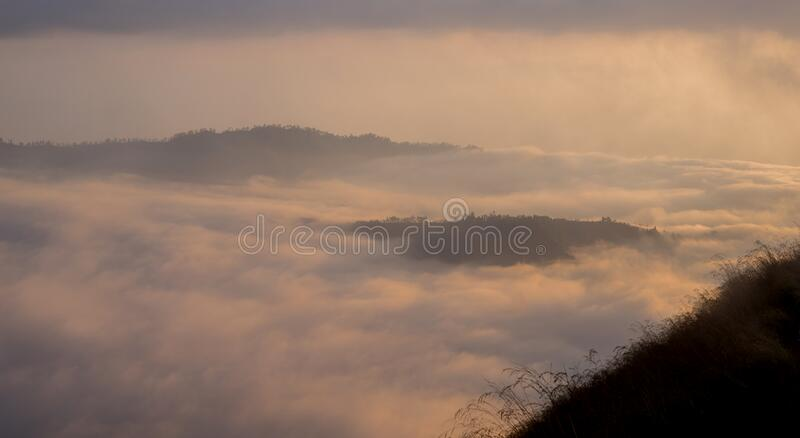 Scenic view of clouds and mist at sunrise. From the top of mount Batur Kintamani volcano, Bali, Indonesia royalty free stock images