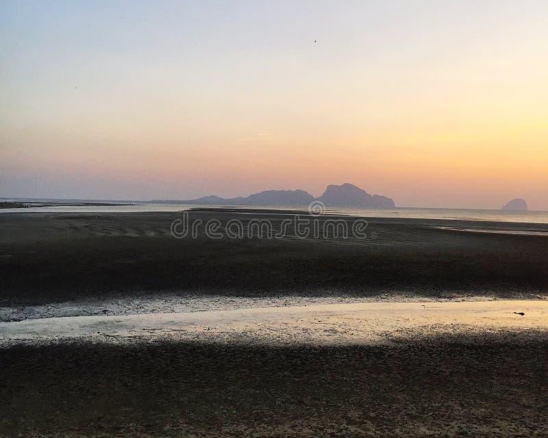Scenic view of coast against sunset sky. Sea, beach, seaside, seashore, sand, tide, low-tide, bright, romantic-sky, moody-sky, coastline, water, weather stock photos
