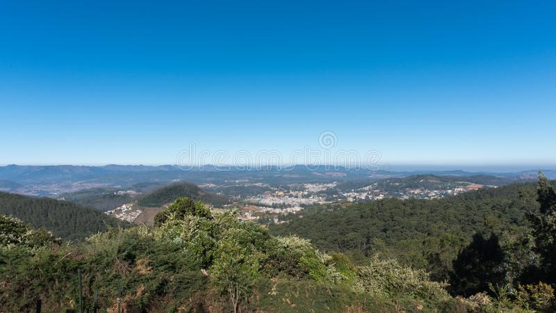 Scenic view from Doddabetta peak, highest peak in nilgiri district, forest reserve with the blue sky background. stock photo