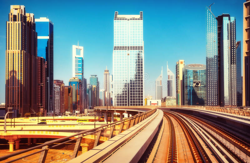 Scenic view of the Dubai skyscrapers at daytime. Modern architecture of Dubai UAE, seen from a metro car. Scenic view of the Dubai skyscrapers. Travel background royalty free stock photo
