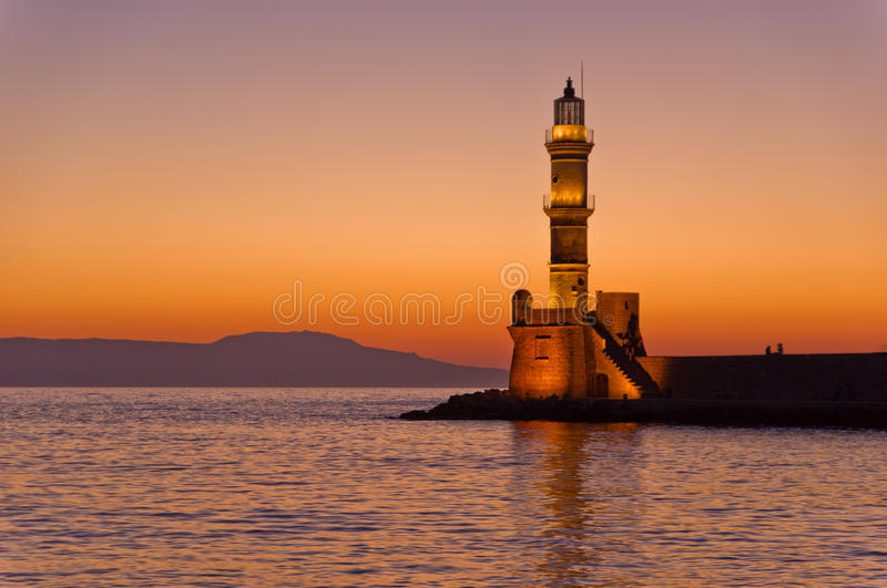 Scenic view of the entrance to Chania harbor with lighthouse at sunset, Crete. Greece stock images
