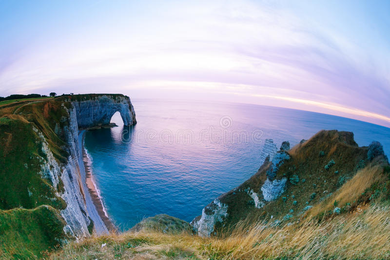 Scenic view of Etretat chalk cliffs at sunset stock image