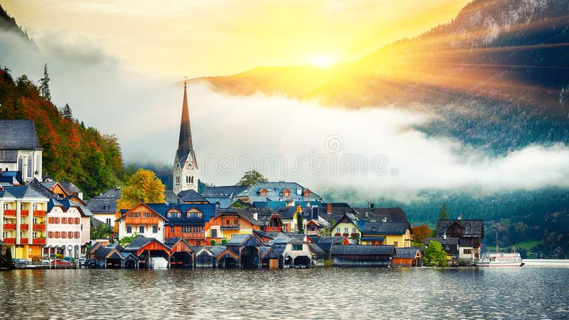 Scenic view of famous Hallstatt mountain village with Hallstatter lake. Foggy autumn sunrise on Hallstatt lake. Location: resort village Hallstatt stock images