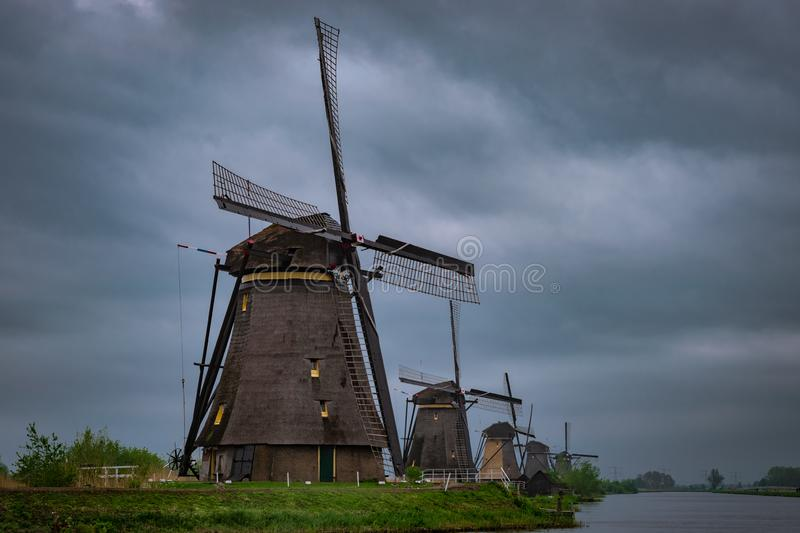 Five traditional windmills in a row in Kinderdijk, Holland. royalty free stock photos