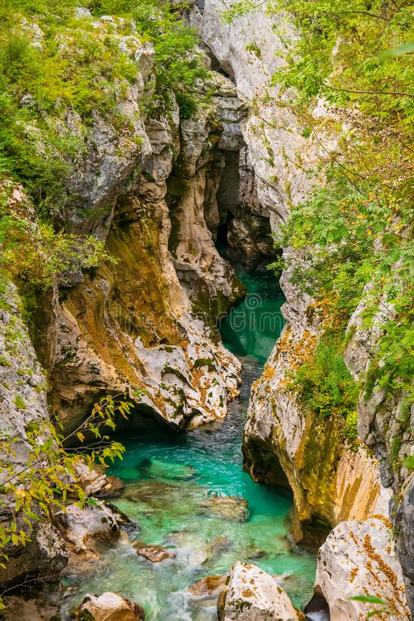 Scenic view of Great Canyon of Soca river near Bovec, Slovenia at summer day. Azure waters of river Soca flowing through a narrow and deep rocky gorge and cave stock photography