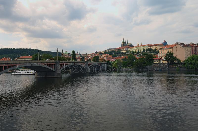 Scenic view of historical center of Prague, Manes Bridge and Vltava river at cloudy summer day. Buildings, cathedrals and landmark. S of old town, Prague, Czech royalty free stock photos