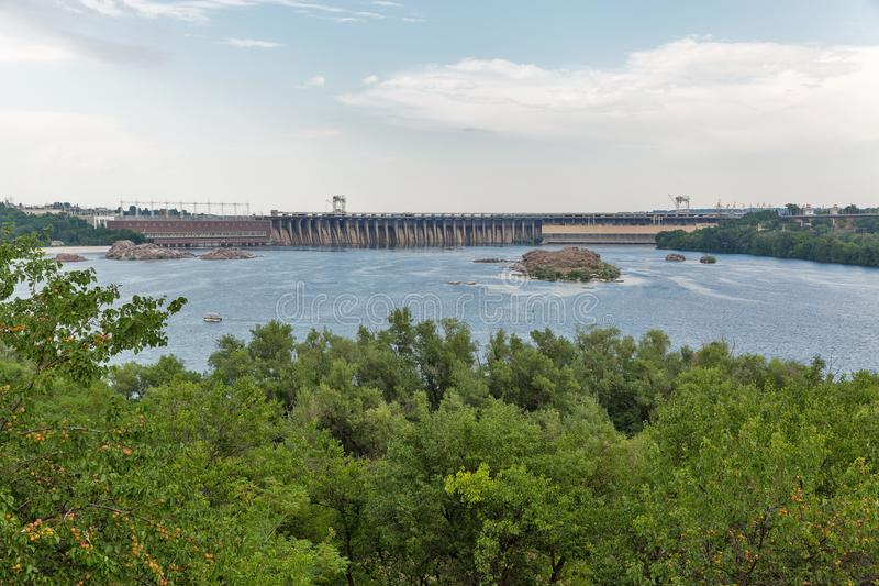 Khortytsia island, Dnieper River and hydroelectric power plant. Zaporizhia, Ukraine. Scenic view from the island of Khortytsia with Zaporozhskaya Sich to the royalty free stock photo