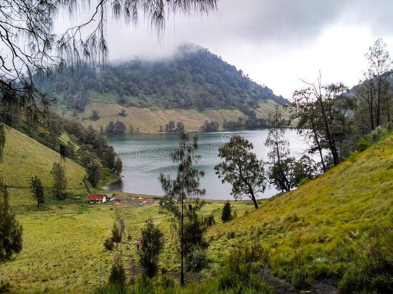 Scenic view of Lake against cloudy sky. This photo located in Ranu Kumbolo lake Indonesia royalty free stock image