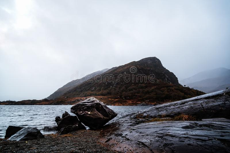 Scenic view of lake against mountian in Killarney. National Park a misty day in the Ring of Kerry in Ireland stock photo