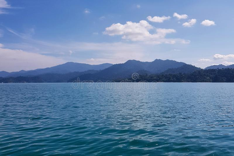 Scenic view of lake against mountian range royalty free stock images