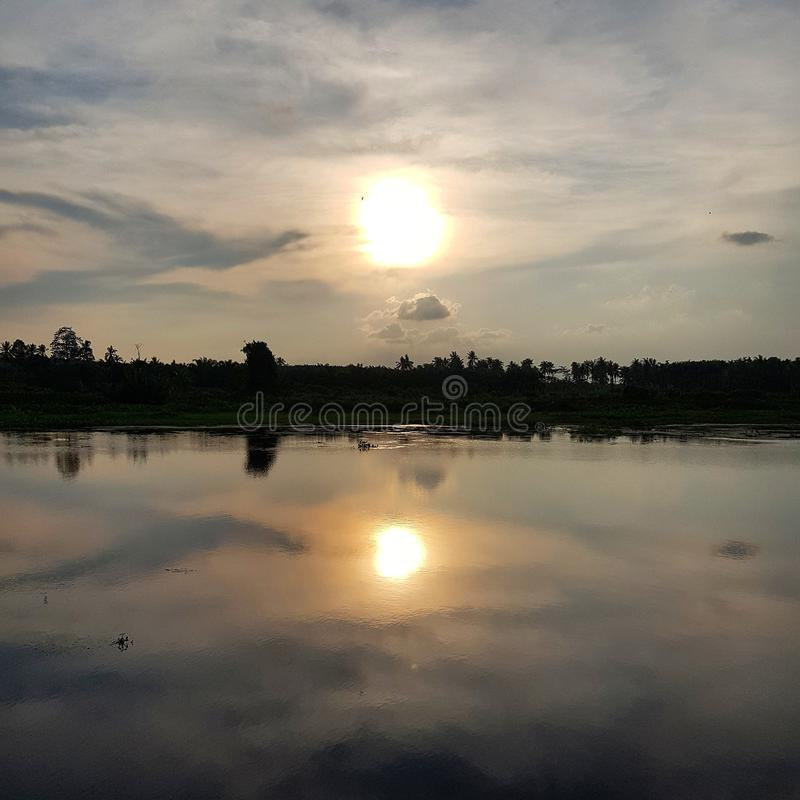 Scenic view of lake against sunset sky. River, water, reflection, nature, outdoor, relaxing, park, idyllic, calm, tranquility, daylight, clouds, lake-view stock image