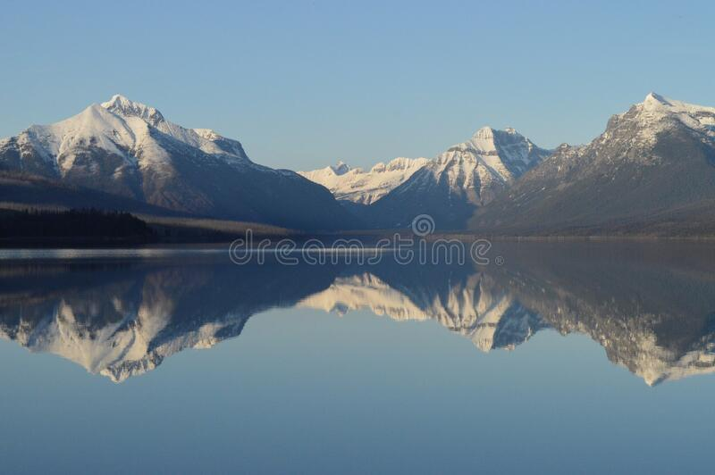 Scenic View of Lake and Mountains Against Sky royalty free stock image