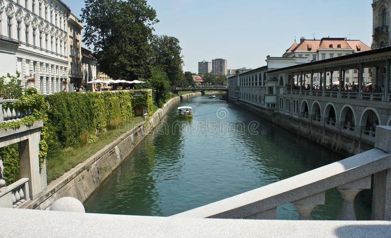 Scenic view of the Ljubljanica river in old town, beautiful architecture, sunny day, Ljubljana, Slovenia royalty free stock photos